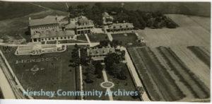 "Hershey Industrial School (Milton Hershey School) boys spell out ""H E R S H E Y"" in front of the school greenhouse. 1923"