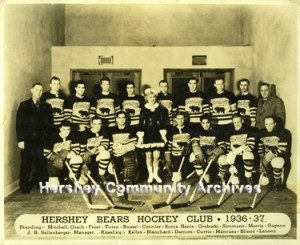 Hershey Bears ice hockey team with ice skater Sonja Henie. 1/18/1937