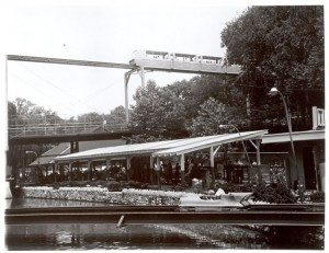 Monorail passes over the Hershey Park Turnpike ride. ca.1969
