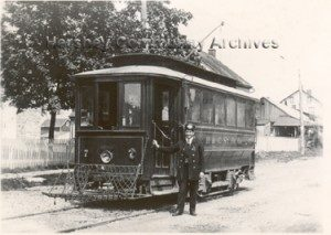 Conductor William Harper stands beside his Hershey trolley. ca.1906