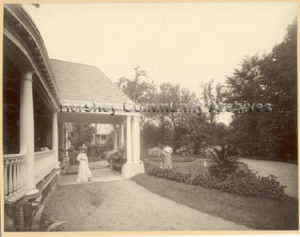 Catherine Hershey standing in the driveway for 222 South Queen Street, Lancaster, PA. ca.1900