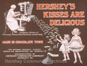 In-store poster promoting Hershey's Kisses with its trademark plume. 1921
