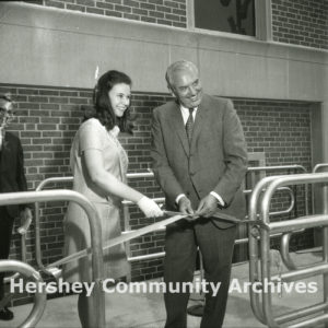 Miss Pennsylvania, Trudy Pedersen, and Pennsylvania Secretary of Commerce, Robert Mumma, cut the ribbon at the Monorail dedication, June 20, 1969
