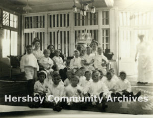 Catherine Hershey and her mother-in-law, Fanny Hershey, seated with Hershey Industrial School students in High Point, 1912