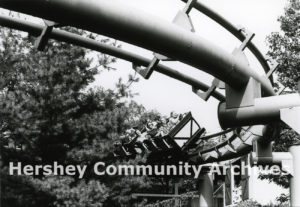 Trailblazer roller coaster trains coming around a sharp bend, ca. 1977-1985