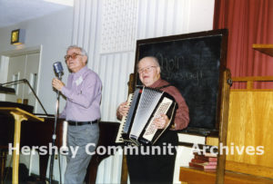 AARP members Virgil Alexander and Packy Payne entertain at a monthly meeting, 1997
