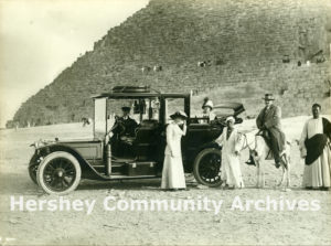 Milton and Catherine Hershey (Catherine seated in the car) visit the Great Pyramids, Giza, Egypt, April 1913