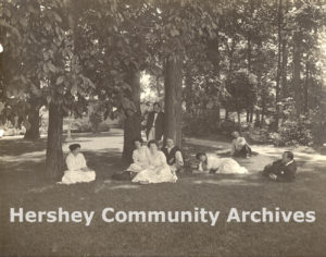 Catherine and Milton Hershey relax with friends under the trees at High Point (Catherine seated third from the left; Milton second from the right), 1911