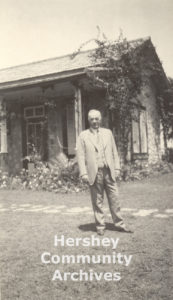 Milton Hershey standing outside his home in Central Rosario, Cuba, ca. 1920
