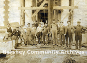 Titzel Construction Company construction crew stands in front of the future Hershey Trust Company, 1913
