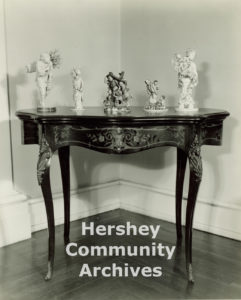 Some of the items from Milton S. Hershey's estate that were sold at auction on December 17 and 18, 1945. Photograph of table and figures, ca. 1970-1980
