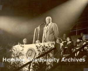 President Eisenhower greets guests from the dais in the Hershey Sports Arena, October 13, 1953
