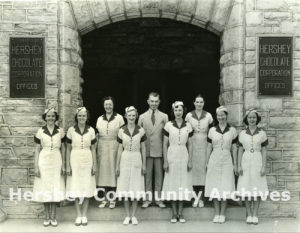 Hershey Chocolate Factory visitors department; Tour Director Lloyd Shoap and hostesses, ca. 1936-1940
