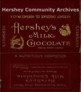 Hershey's Milk Chocolate bar wrapper in gold and maroon. Hershey marketed bars in a variety of sizes, including a 8 ounce bar, retailing for 40 cents. 1902