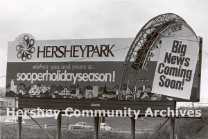 Billboard advertising a new ride coming to Hersheypark for the 1977 summer season.