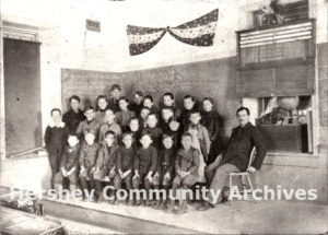 Mr. P.H. Balsbaugh poses with his class, Rockridge School, 1900