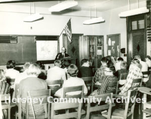 The Junior College offered residents and Hershey employees two years of free college education. Professor William Schmehl lectures to a class, ca. 1950-1959