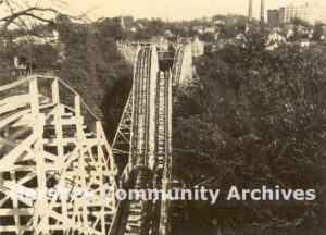 Wild Cat roller coaster looking south east from the top of the first hill, factory in background, ca. 1923-1945